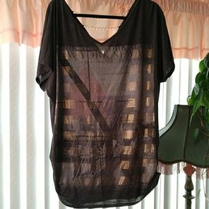 Cute top with V in back with chain accents